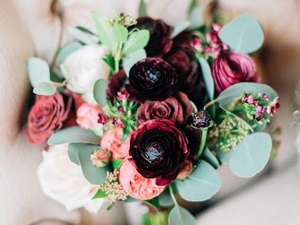 winter bouquet burgundy pinks ranunculus eucalyptus
