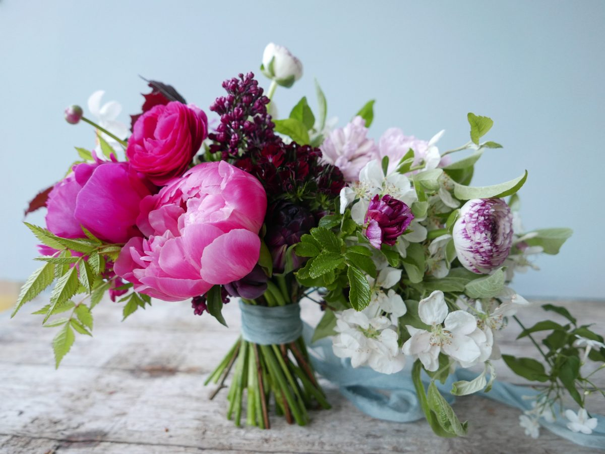 early summer bouquet peonies ranunculus pinks lilac apple blossom